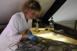Here is Rachel is delicately cleaning medieval glass from St Mary the Virgin Church, Ewelme.